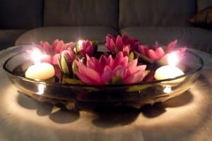 interior-pink-lotus-flowers-with-white-candles-placed-on-the-glass-bowl-flower-centerpieces-with-candles-sweeten-your-room